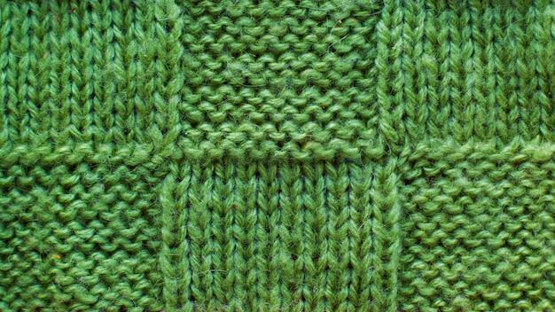 Lana verde di filato tricottato, primo piano del tessuto tricottato modello di struttura Foto Premium