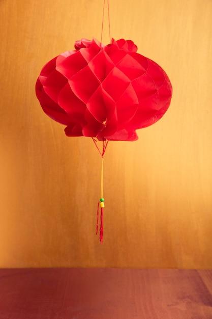 Lanterna cinese di nuovo anno con sfondo dorato Foto Gratuite