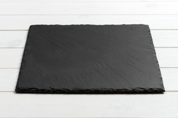 Lavagna dell'ardesia sulla tavola di legno Foto Premium