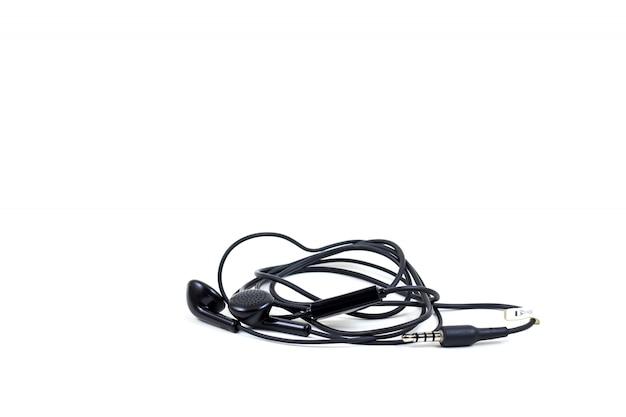 Le cuffie nere con la cuffia avricolare si trovano su fondo isolato bianco Foto Premium