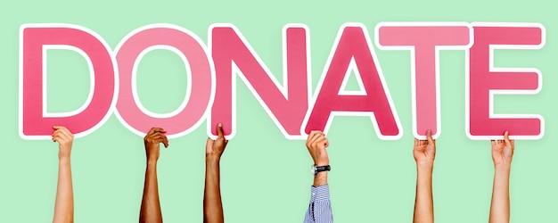 Le lettere rosa che formano la parola donano Foto Gratuite