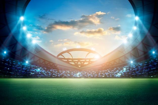 Le luci alla notte e lo stadio 3d rendono Foto Premium