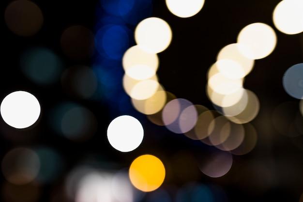 Le luci circolari astratte hanno offuscato il fondo di festa del bokeh Foto Gratuite