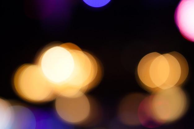 Le luci hanno offuscato il fondo del bokeh dalla festa di notte per la vostra progettazione Foto Premium