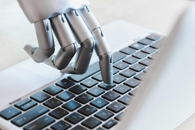 Le mani e le dita del robot indicano il concetto robotizzato di intelligenza artificiale del chatbot del computer portatile del consulente del bottone Foto Premium