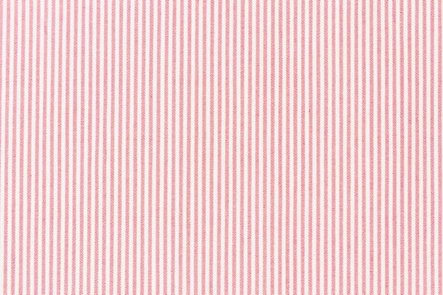 Linea a strisce rossa su sfondo con texture tessuto bianco Foto Gratuite