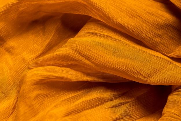 Liscio elegante tessuto arancione trama del materiale Foto Gratuite