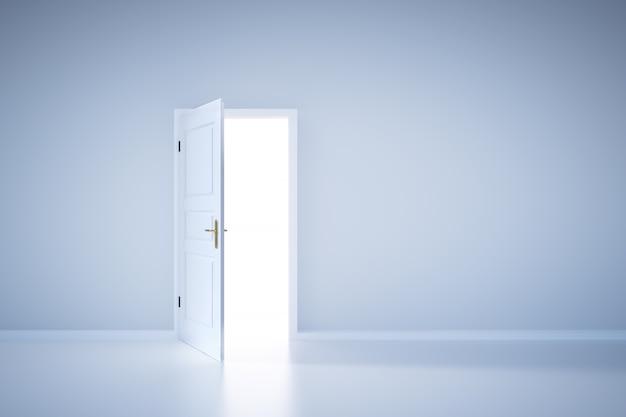 Luce che brilla dalla porta aperta. ingresso Foto Premium