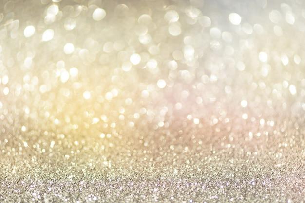 Luci astratte del bokeh dell'oro e dell'argento. priorità bassa lucida di scintillio con lo spazio della copia. Foto Premium