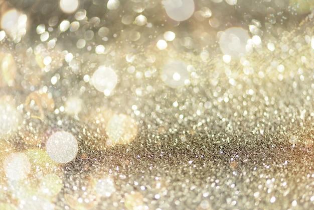 Luci astratte del bokeh dell'oro e dell'argento. Foto Premium