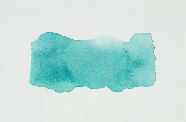 Macchia di acquamarina di vernici su carta bianca Foto Gratuite