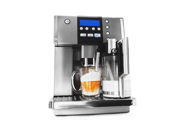 Macchina da caffè automatica con una tazza di caffè Foto Premium