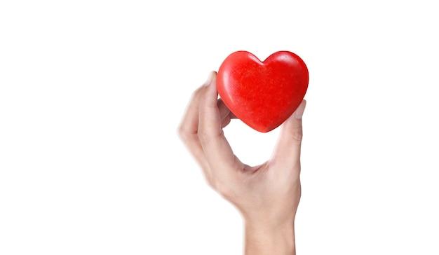 Mani che tengono un cuore rosso, salute del cuore Foto Premium