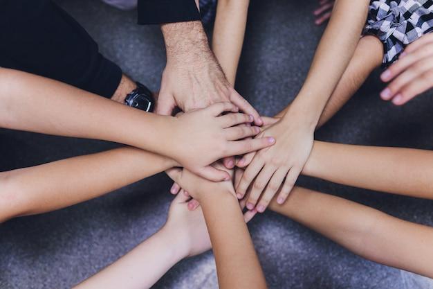Mani insieme sulla squadra Foto Premium