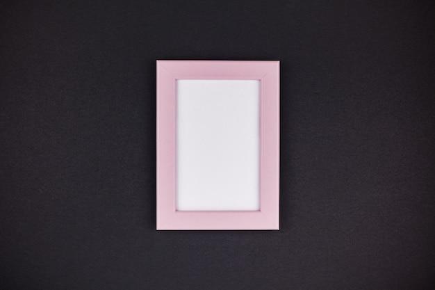 Manichino di una cornice rosa millenaria Foto Premium