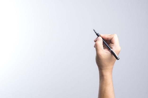 Mano che regge una penna per la firma o la scrittura Foto Premium