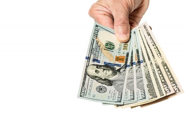 Mano che tiene i soldi dollari, isolati su bianco Foto Premium
