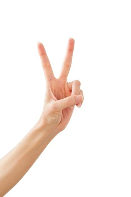 Mano della donna che mostra pace due su bianco Foto Premium