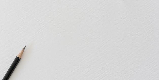Matita nera su priorità bassa di carta acquerello superficie bianca Foto Premium