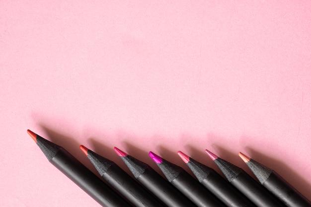 Matite Di Colore Rosa Tono Nero Su Sfondo Rosa Pastello Scaricare