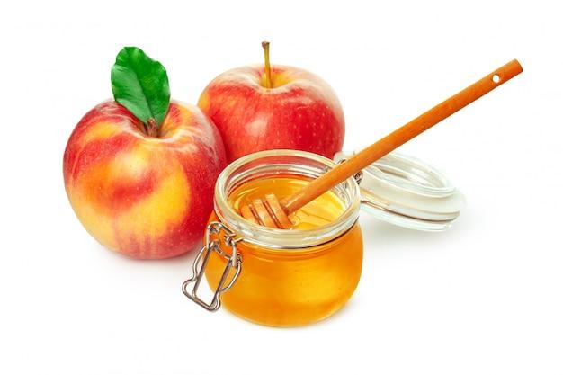 Mele e vaso del miele per la festa ebrea del nuovo anno isolata Foto Premium