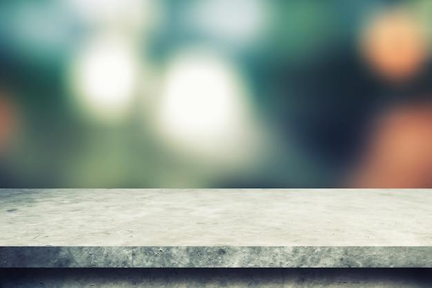 Mensola di cemento con sfocatura sfondi bokeh, per prodotti di visualizzazione Foto Premium