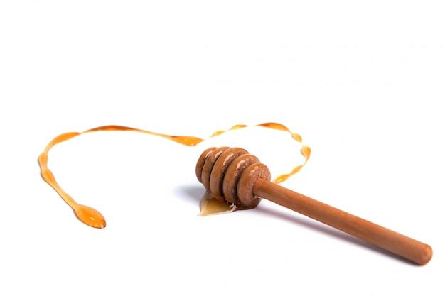 Merlo acquaiolo del miele con miele a forma di cuore Foto Premium