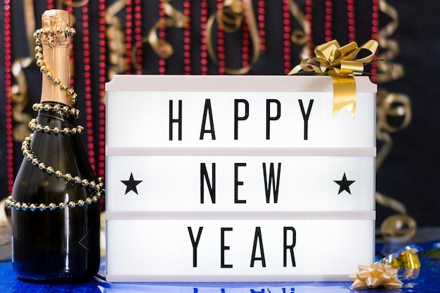 Messaggio di vista frontale per l'evento del nuovo anno Foto Gratuite