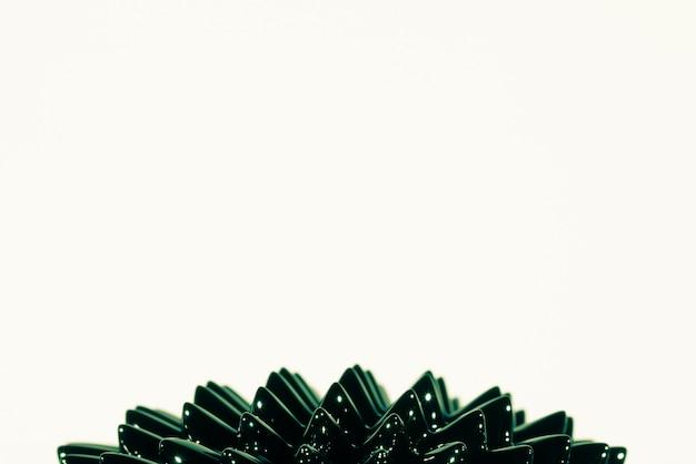 Metallo liquido ferromagnetico verde con spazio di copia Foto Gratuite
