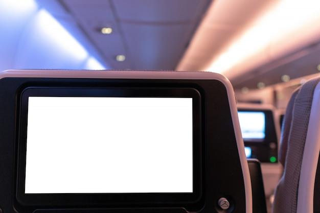 Mock-up bianco vuoto dello schermo multimediale dell'aeromobile. Foto Premium