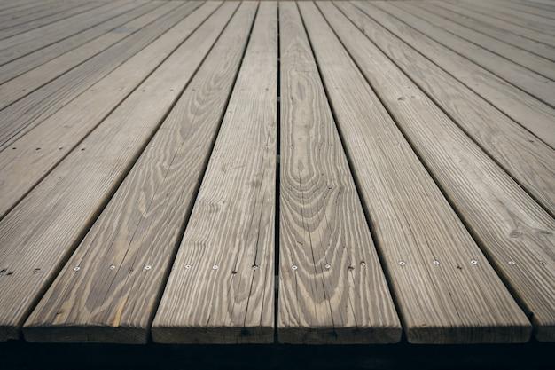Mock up prospettiva vuota superiore tavola di legno. utilizzando come sfondo il concetto di montaggio Foto Premium
