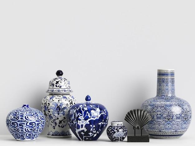 Mockup di decorazioni interne con vasi di zenzero cinese e coralli Foto Premium