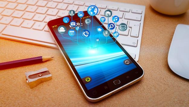Moderno telefono cellulare con icone che volano sopra Foto Premium