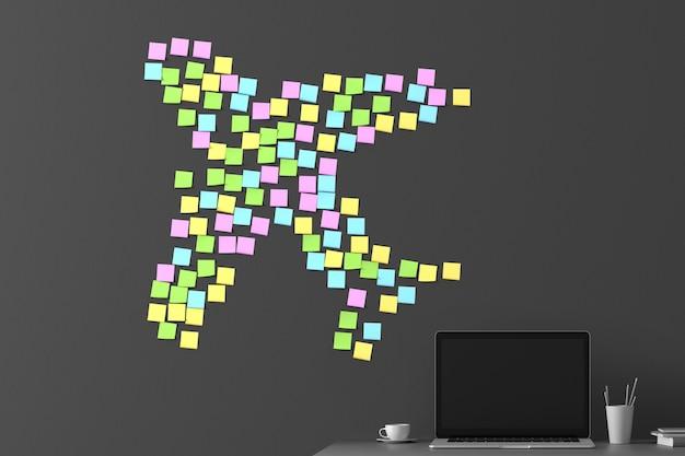 Molti adesivi incollati su un muro grigio scuro a forma di aereo in volo Foto Premium