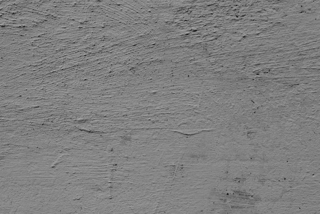 Muro di cemento con crepe e graffi Foto Premium