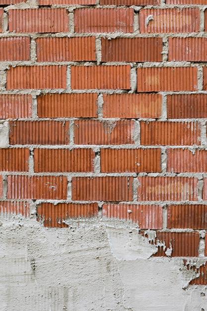 Muro di mattoni a vista con intonaco Foto Gratuite