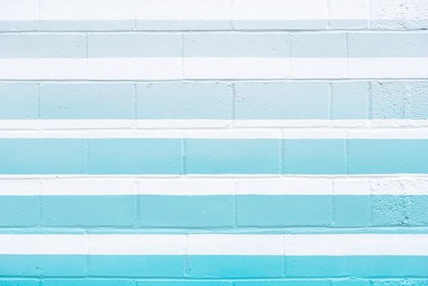 Muro di mattoni astratto con linee blu Foto Gratuite
