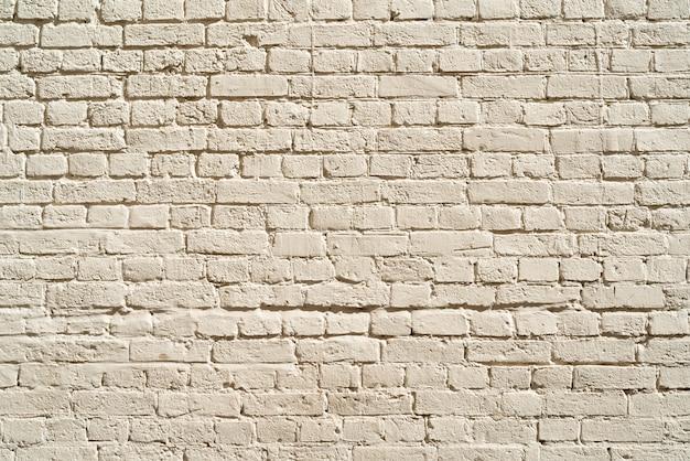 Muro di mattoni beige. loft interior design. vernice beige della facciata. Foto Premium