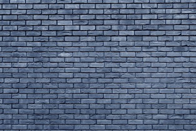 Muro di mattoni blu. interior design loft. vernice blu della facciata. sfondo architettonico. Foto Premium