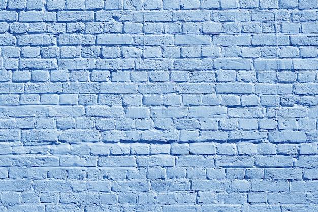 Muro di mattoni blu. loft interior design. vernice blu della facciata. Foto Premium