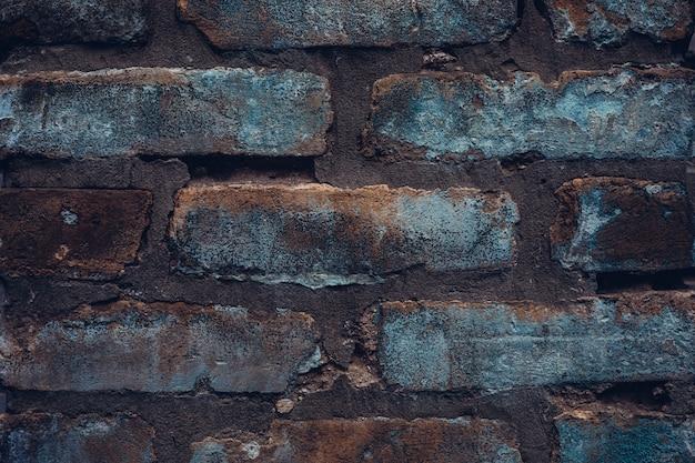 Muro di mattoni in stile denim grezzo. sfondo texture vintage rustico Foto Premium