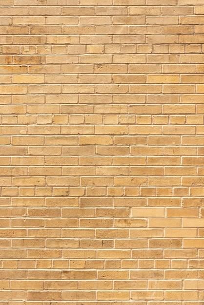 Muro di mattoni invecchiato sullo sfondo Foto Gratuite