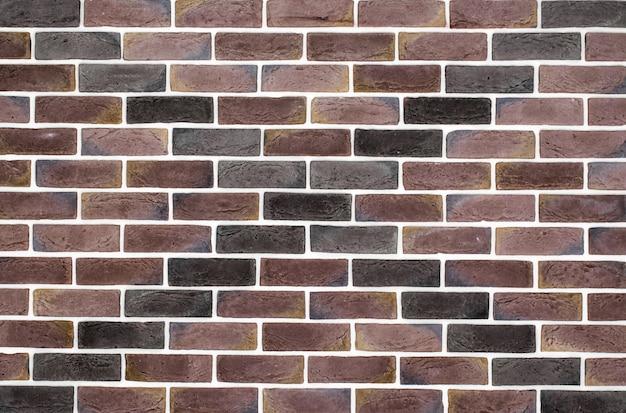 Muro di mattoni marrone chiaro con motivo Foto Gratuite
