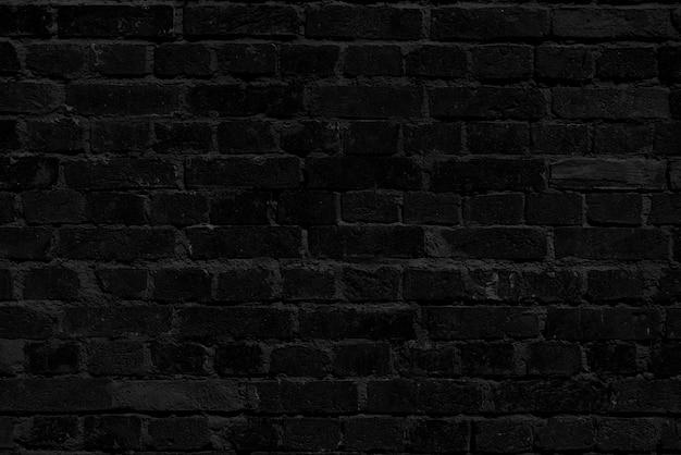 Muro di mattoni neri. interior design loft. vernice nera della facciata. Foto Premium