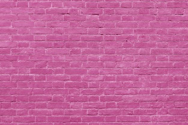 Muro di mattoni rosa. interior design loft. vernice rosa della facciata. sfondo architettonico. Foto Premium