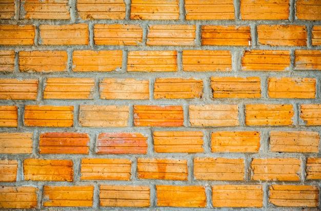 Muro di mattoni rosso d'annata. vecchio muro di mattoni, vecchia struttura della pietra rossa blocca il primo piano. Foto Premium