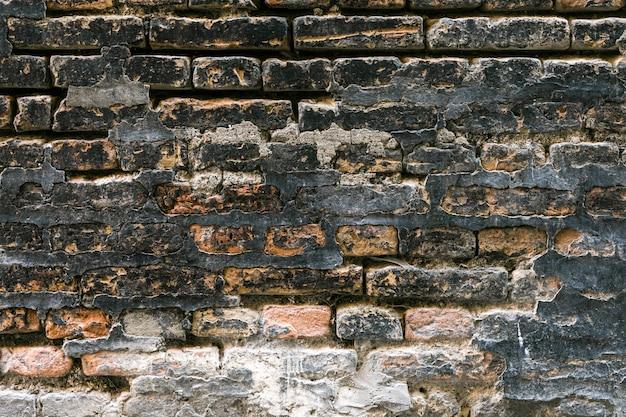 Muro di mattoni ruvido e sporco Foto Gratuite