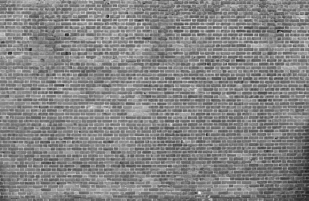 Muro di mattoni solido grigio stagionato della vecchia annata naturale Foto Premium