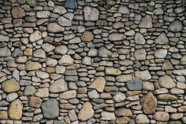 Muro di pietra grigia con bellissimi motivi. Foto Premium