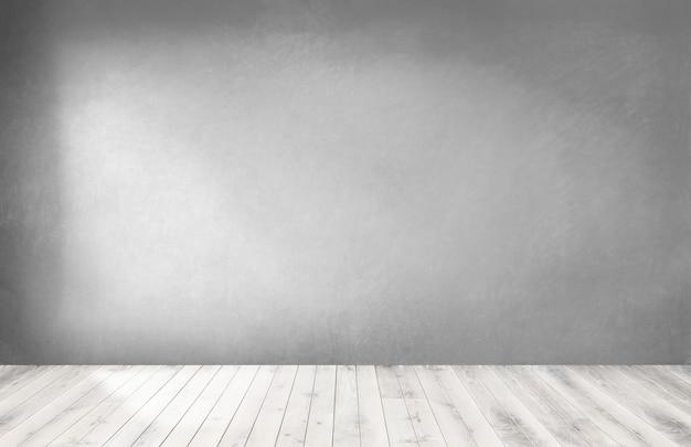 Muro grigio in una stanza vuota con un pavimento in legno Foto Gratuite